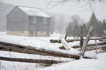 Rustic Barn And Fence In Winter