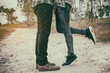The couple kissing, Couples foots stay at the street.