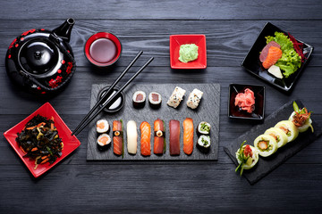 Fototapeta Sushi set on black background top view