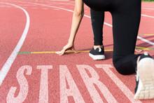 Athlete On Starting Line Waiting For The Start In Running Track