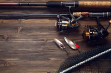 Fishing Tackle - Fishing Spinning, Hooks And Lures On Wooden Bac