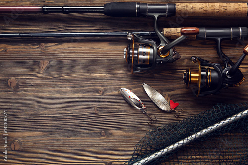 Cadres-photo bureau Peche Fishing tackle - fishing spinning, hooks and lures on wooden bac