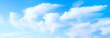 Leinwandbild Motiv Idyllic white fluffy clouds in the blue sky panoramic positive background