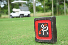 Sign At Tee Off With Golf Cart On Golf Course