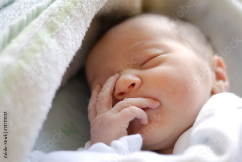 Newborn baby girl in hostpital bed sleeping