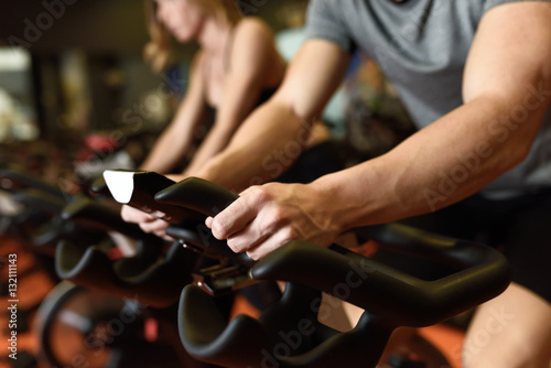Couple in a spinning class wearing sportswear. Fototapeta