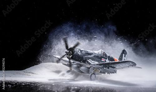 Fotografía World war II military aircraft with heavy snowfall