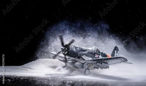 Canvas Print World war II military aircraft with heavy snowfall