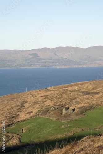 Photo A derelict farm house on the Sheeps Head Peninsula County Cork Ireland looking n