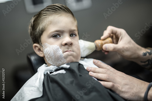 Humorous shaving of little boy Canvas Print