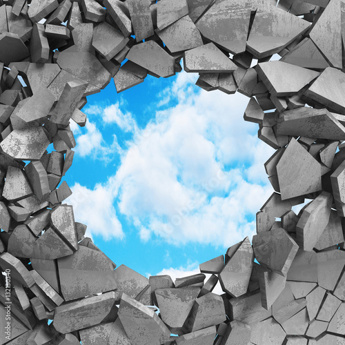 Cracked damage hole in concrete wall to cloudy sky