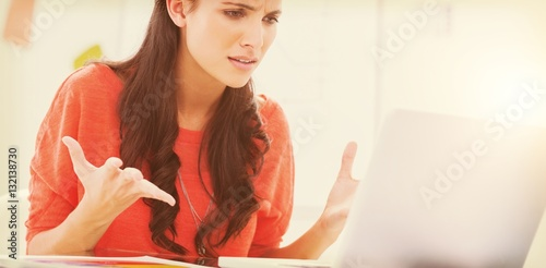 Fotografie, Obraz  Annoyed designer gesturing in front of her laptop