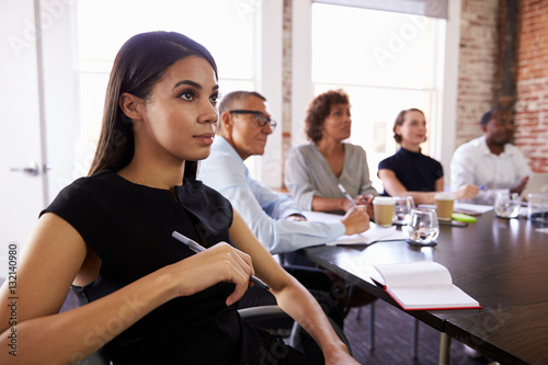 Photo  Businesspeople Listening To Presentation In Boardroom