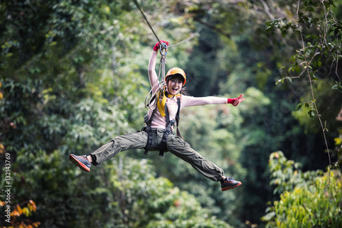 Poster Lieu connus d Asie Woman Tourist Wearing Casual Clothing On Zip Line Or Canopy Experience In Laos Rainforest, Asia