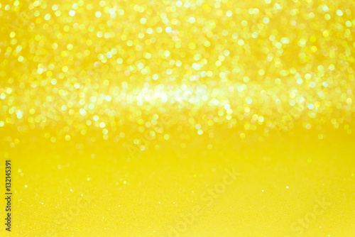 Tuinposter Bier / Cider Defocused abstract yellow glitter with bokeh background