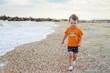 Little boy playing on the beach.Child runs on the beach