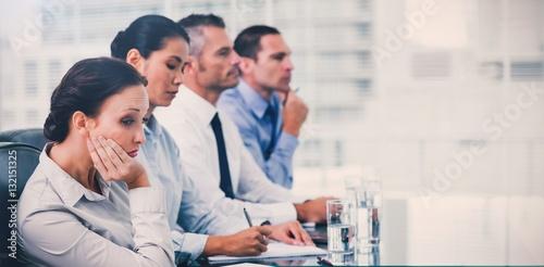 Fotografie, Obraz  Businesswoman getting bored while attending presentation