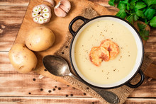 Homemade Potato Cream Soup With Potato Chips On Wooden Table
