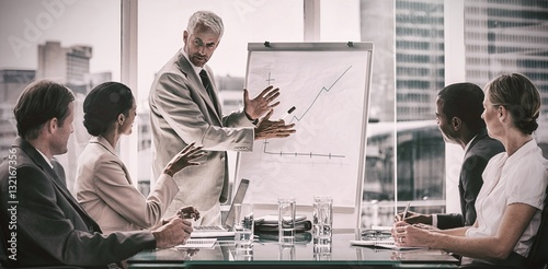 Fotografie, Obraz  Businessman in front of a growing chart during a meeting