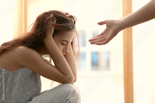 Someone giving hand to depressed woman at home Fototapet