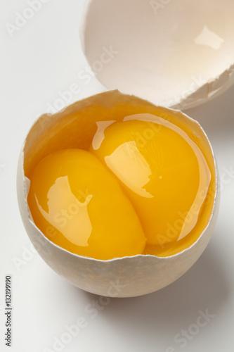 Broken double yolk egg