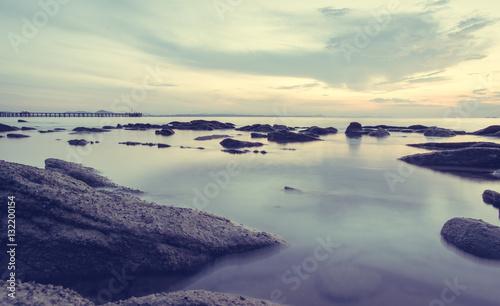 Foto op Aluminium Poolcirkel Stone Beach in vintage style