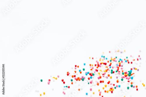 Valokuva sprinkles on a white background. Festive background for Valentin