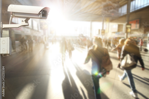 Tuinposter CCTV camera or surveillance operating with crowded people in background