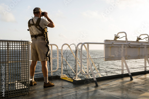 Guard on board sea going vessel in aden gulf Fototapet