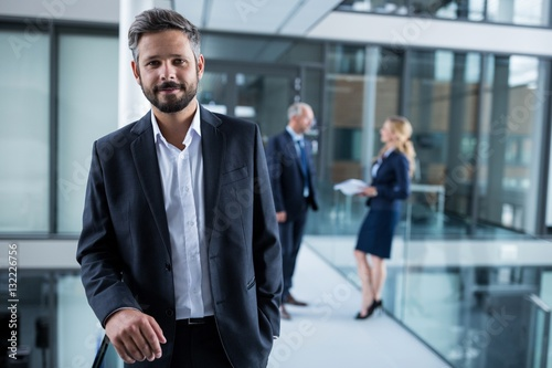 Fototapety, obrazy: Businessman standing in office corridor