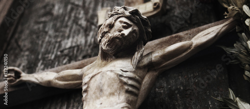 Fotografija  a wooden sculpture of crucified Jesus Christ  (styled retro)