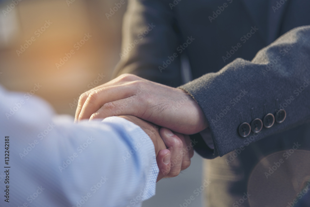 Fototapeta Trust Promise Concept. Honest Lawyer Partner with Professional Team make Law Business Agreement after Complete Deal. Ethics Business people handshake, touch and Respect customer to trust partnership.