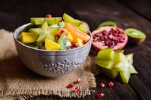Juicy Fruit Salad With Kiwi, Mango, Mandarin, Carambola And Pomegranate
