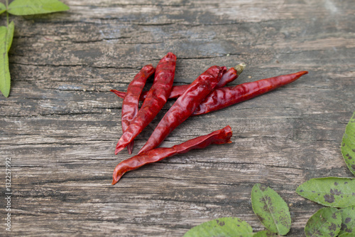Dried red chilly pepper on wooden panel