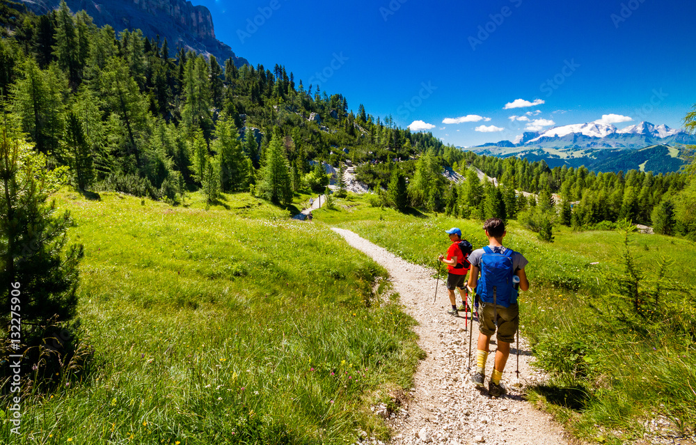 Fototapety, obrazy: Pair of excursionist walking on mountainous trail. Summer Trekking