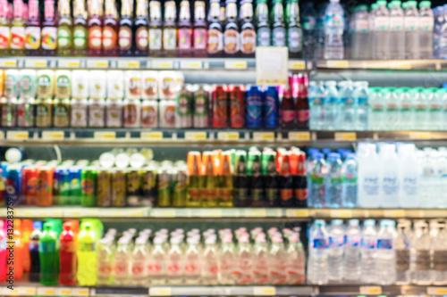 Defocused blur of supermarket shelves with Bottles of Beverages