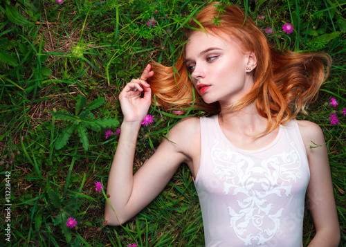 Fotografie, Obraz  Young pretty woman lying on the grass