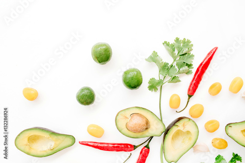Raw food: avocado, chili pepper, coriander, cherry tomato, lime, garlic. Flat lay, top view. Food concept.