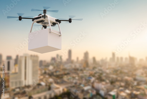 Fotografía  delivery drone flying in city