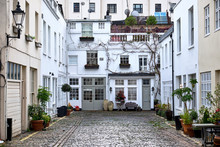 Sussex Mews A Short And Narrow Alley Street With Cobblestones And Low Residential Houses With Vegetation