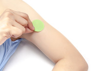 Stick Anti Mosquito Patch On Arm, On White Background Isolated