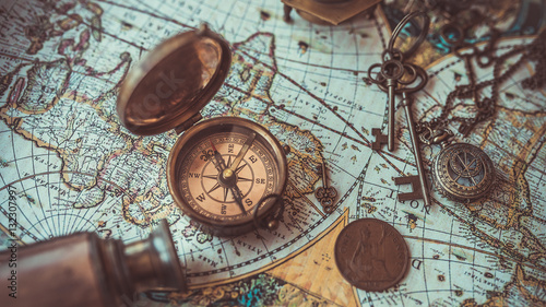 Fototapeta Old collection compass, telescope and collecting rare items on antique world map. (vintage style)  obraz