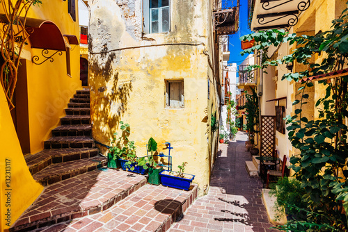Authentic narrow colorful mediterranean street in Cretan town of Chania, island of Crete, Greece