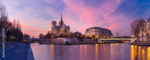 Picturesque grandiose sunset over Cathedral of Notre Dame de Paris, France. Panorama