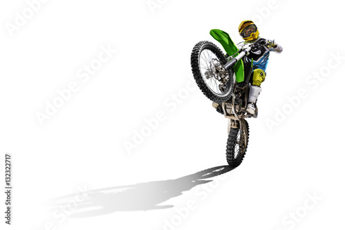 Photo  Dirt bike and rider isolated on white