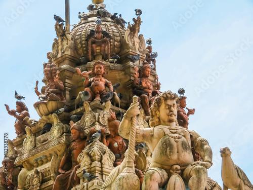 Hindu sculptures near a main entrance in Batu Caves Poster