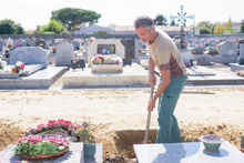 Man Digging Grave In Cemetary