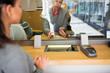 Leinwanddruck Bild - clerk with cash money and customer at bank office