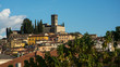 A stone church overlooks the town of Barga in Italy