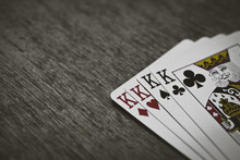 Playing Cards Four Kings. Wooden Background. Game Abstract.